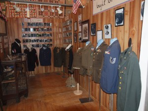 The actual military uniforms of several local men who served in World War II.