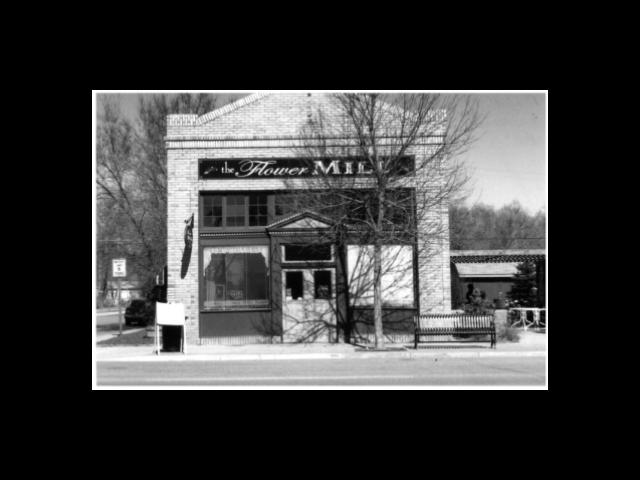 This photo is one of three on record with the National Register of Historic Places for the 1st National Bank of Wellington, which was also The Flower Mill at one point and the Wallen Grocery Store for a time.