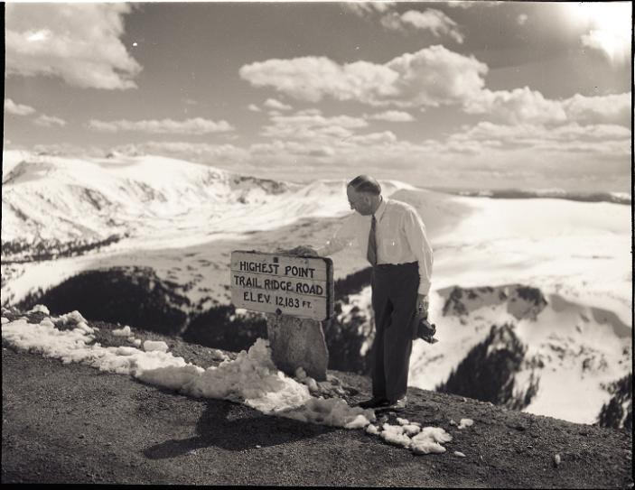 Checking out the highest point on Trail Ridge Road - dated June 14, 1947.