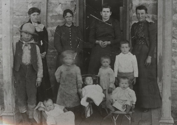 Left to Right: Sally Flowers Beach, Lydia Flowers Pennock, Cora Flowers Tilton, Amanda (Mrs. Ben) Flowers. Front: Arthur Pennock, Alice Pennock. Three to right: Lester, Jasper and Allin Tilton, Beulah Flowers. Baby at left: Eldridge Pennock. (Text and Photo from the Fort Collins Archive - H09564.)