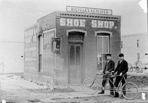 This shoe and bicycle shop stood at the corner of Walnut and Pine, where La Luz is today. It features a tandem bicycle. According to the Courier, the first tandem arrived in town in November of 1899. (Photo from the Fort Collins Archive - H01530.)
