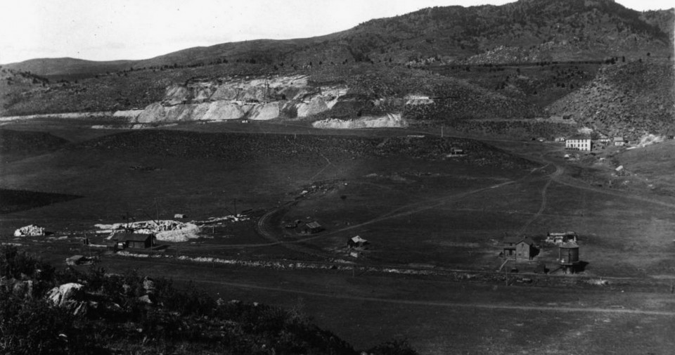 """Stout, Colorado in 1885. The text from the library states, """"Panoramic view over the railroad depot, water tank and tracks of the Colorado & Southern railroad at Stout (also known as Petra), Colorado in Larimer County; includes the quarry and boarding hotel."""" (Call # X-13708)"""