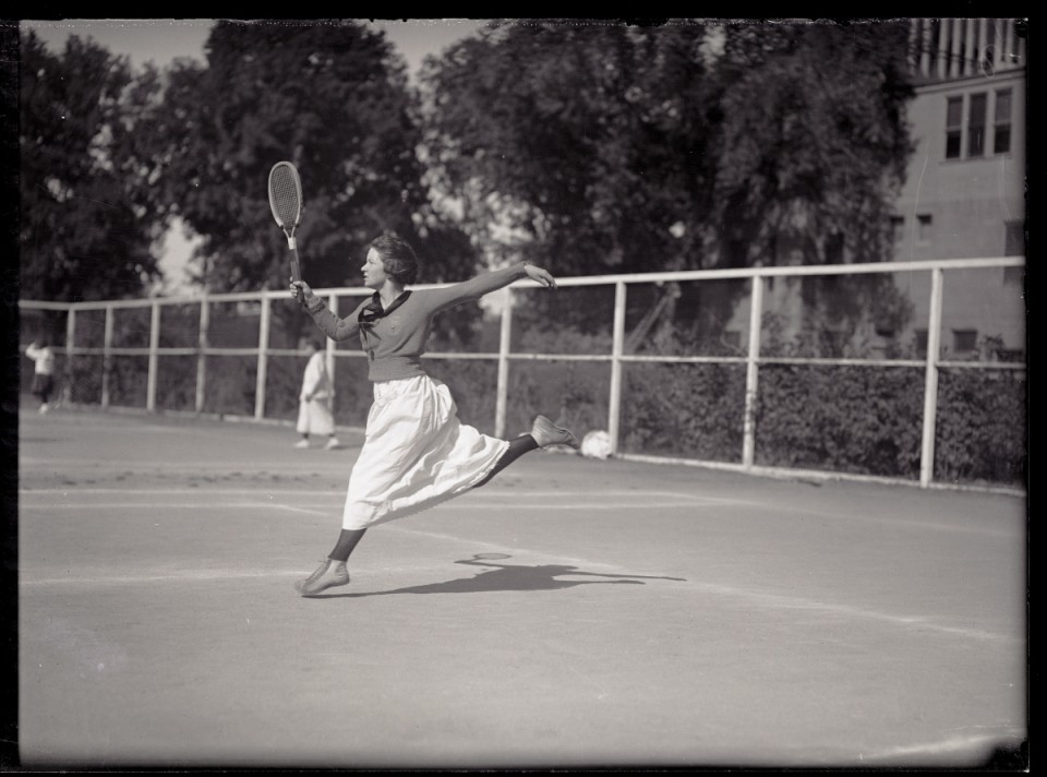 Miss House playing tennis at the Colorado Agricultural College in 1919. This photo is from the Colorado Statue University Archive. ID #: UHPC_1755