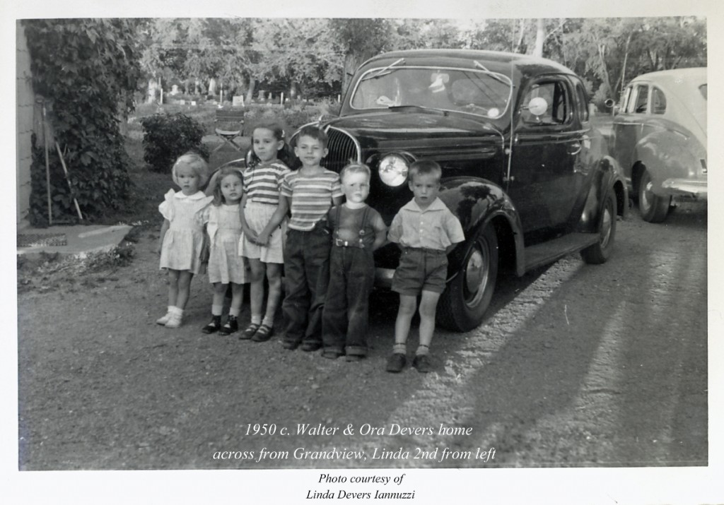 Linda, second from the left, stands with her cousins in front of a car near the cemetery in 1950.