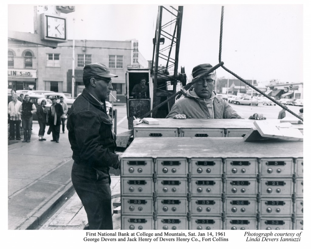 George Devers and Jack Henry of Devers Henry Company position the safety deposit boxes.