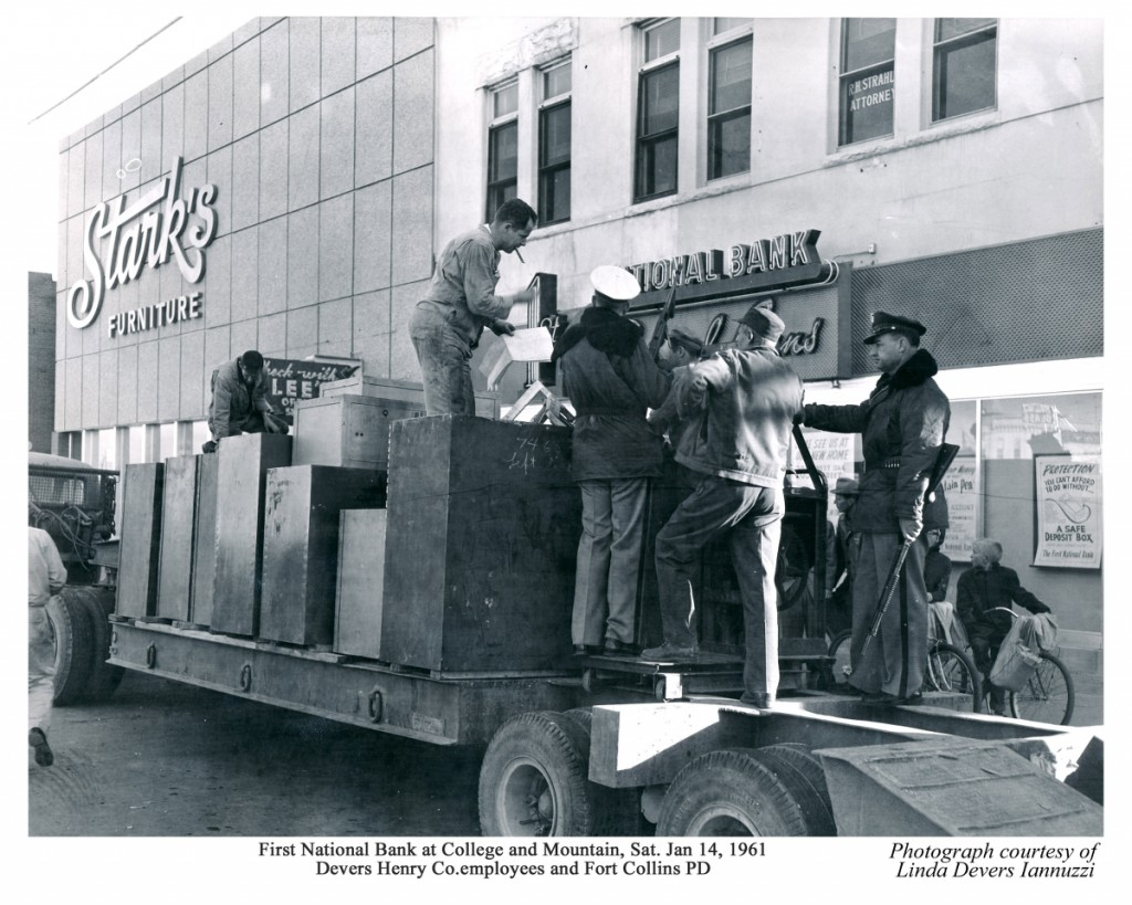 Then men strapped the safety deposit boxes onto the back of the truck. Stark's furniture store can bee seen in back.