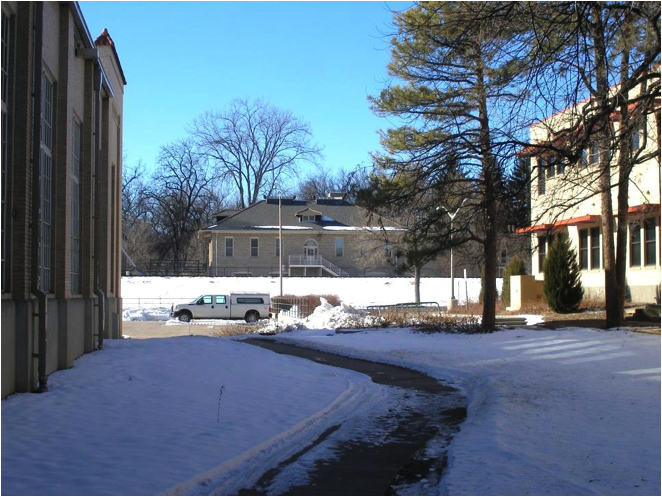 View of Gibbons building (originally Entomology), from tennis courts area of 1919. (Photo by Dean R. Schachterle.)