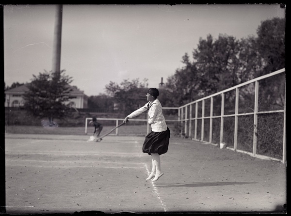Miss Foster playing tennis in 1919. Note the Heating Plant & Entomology building to west. (UHPC_1757)