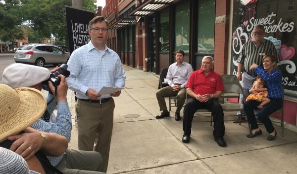 Jon-Mark Patterson gave a short presentation. Mayor Cecil Gutierrez sits in the background.