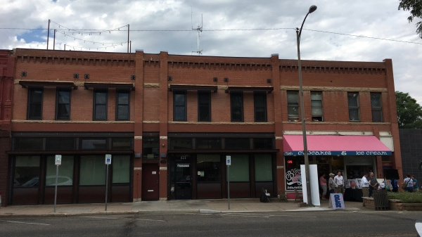 The Loveland Buggy Top building. 419 and 425 East 4th Street.