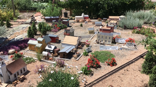 Loveland lays out in miniature with a small train line running past.