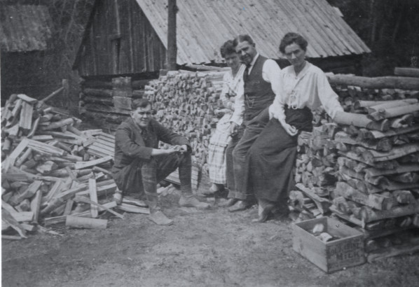 This circa 1900 photo from the Fort Collins Archive shows Mrs. Anna Scott, A.W. Scott, Lulu Scott Abbott, and an unknown man (sitting). The ice house can be seen behind the wood pile. (FC Archive #H06065.)
