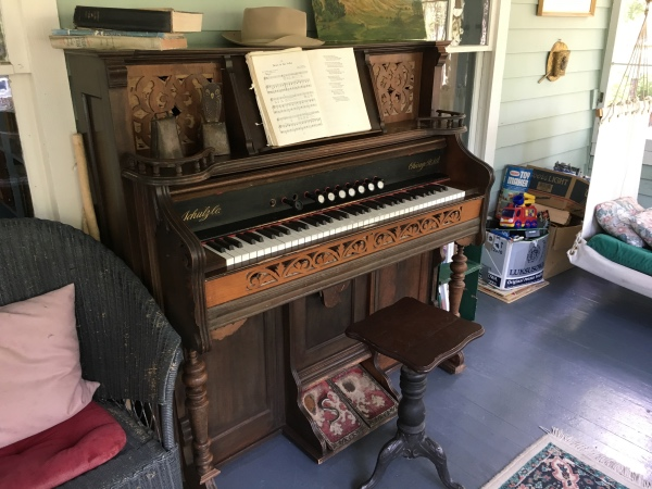 Pump organ on the front porch.