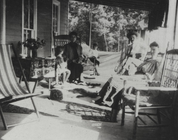 This photo from the Fort Collins Archive shows the porch of Pinehurst before it was enclosed. From right to Left are Anna B. Scott, A.W Scott, Earl Abbott, Lulu Maxwell Abbott, and Anna May Abbott. (FC Archive #H10786)