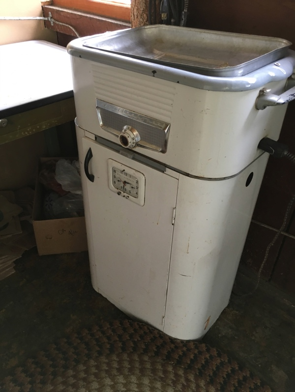 Original furniture and appliances remain throughout the property.