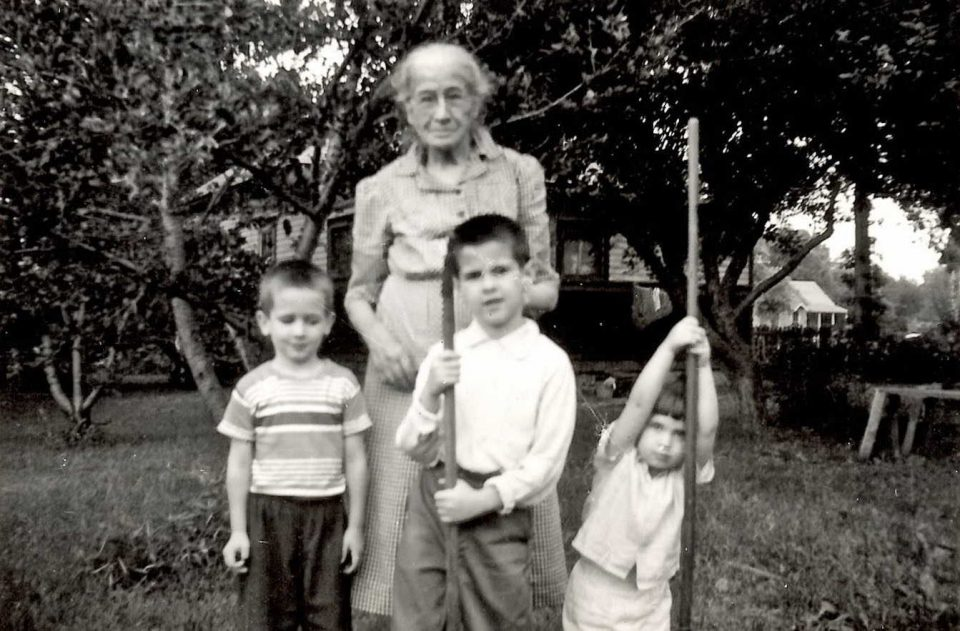 Gussie with her son Paul's children. (Photo from Joseph Lariviere via Ancestry.com.)