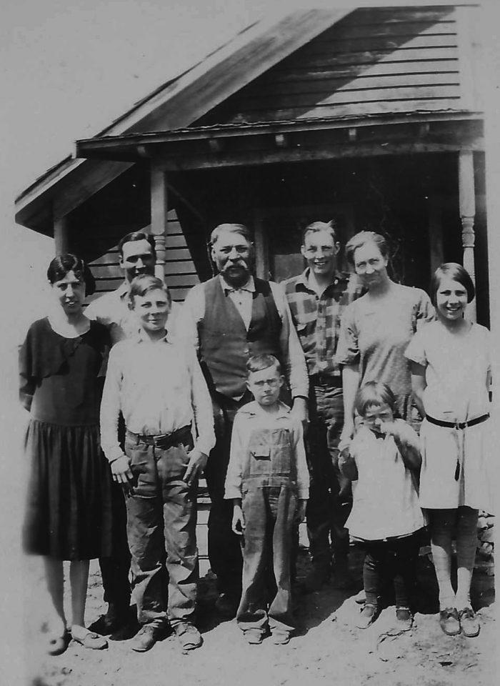 Joe's family -- including one grandson. (Photo from Marie Tocco via Ancestry.com.)