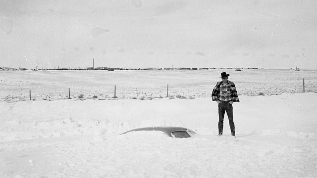 Car buried in snow during the blizzard of January 2-5, 1949. Photo from Wyoming PBS.