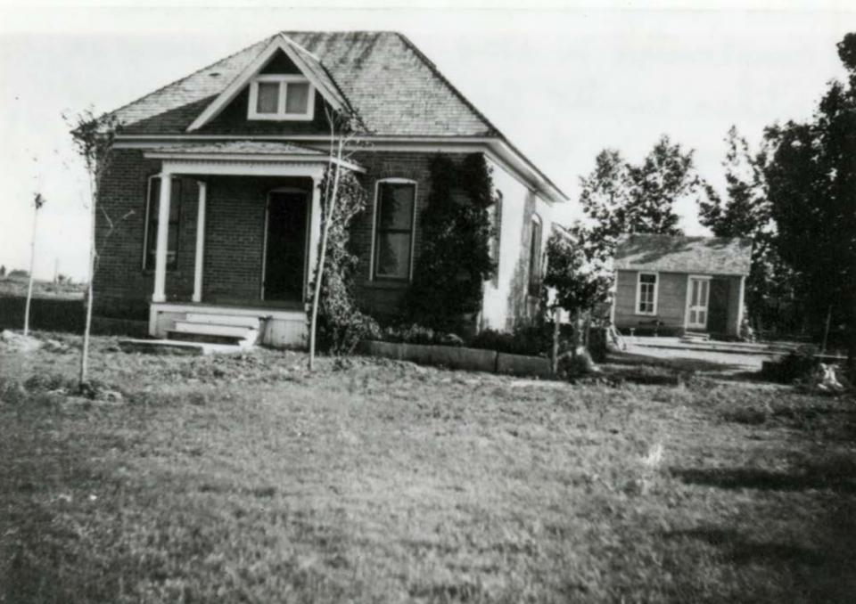 The brick house that the Ross family built is shown here with the smaller proving-up house behind. (Image from the Landmark Preservation Commission agenda of March 15, 2017.)